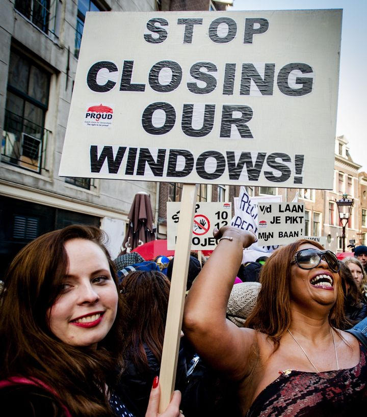 Sex workers and supporters demonstrate in April 2015 against closing window brothels in Amsterdam's red light district.