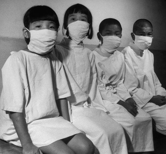 """Hiroshima's children patiently wait their turn for a complete and detailed physical examination in ABCC's [Atom Bomb Casualt"