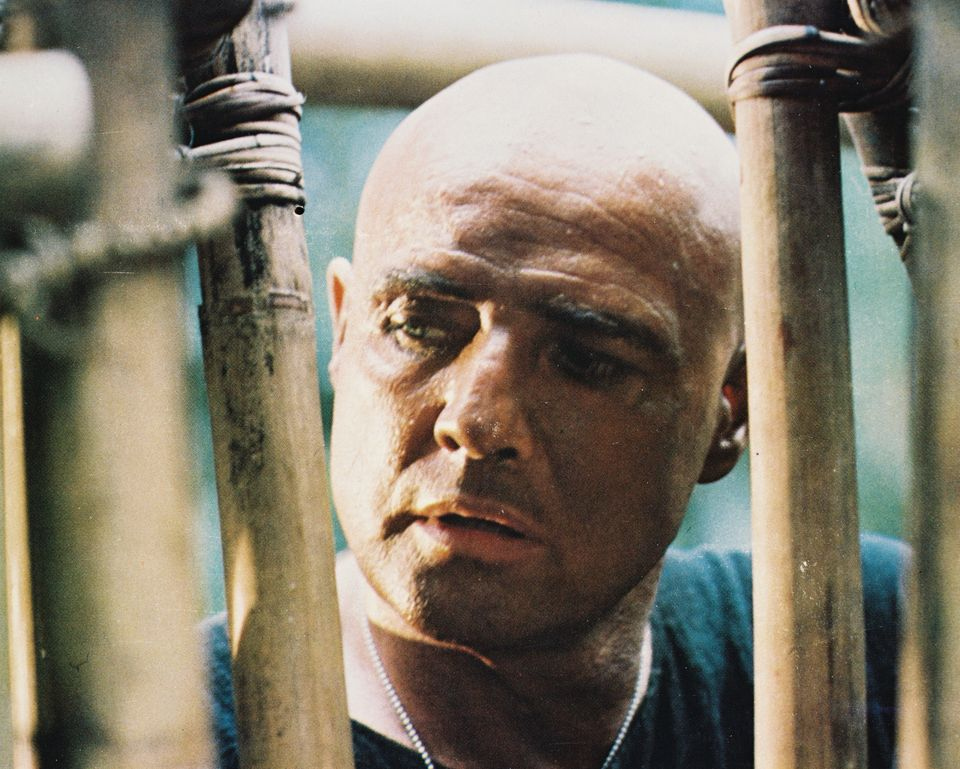 Marlon Brando (1924-2004), US actor, shaven headed in a bamboo cage in a publicity still issued for the film, 'Apocalypse Now