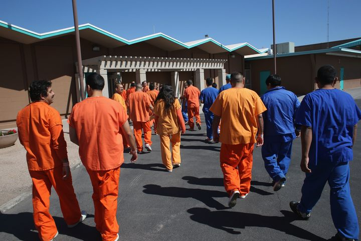 <p>Immigrant detainees walk through the Immigration and Customs Enforcement detention facility on Feb. 28, 2013, in Florence, Arizona. Many Latino groups and immigrant rights organizations criticized Jeb Bush's immigration proposal for failing to address in detail the status of undocumented people living in the country.</p>