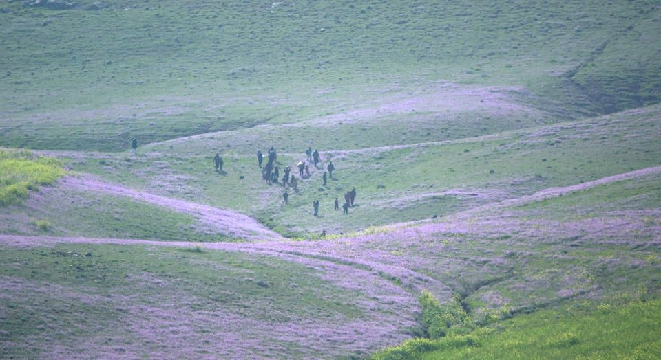 The group of kidnapped people escape across the frontline from ISIS-controlled territory near Sinjar Mountain, Iraq.