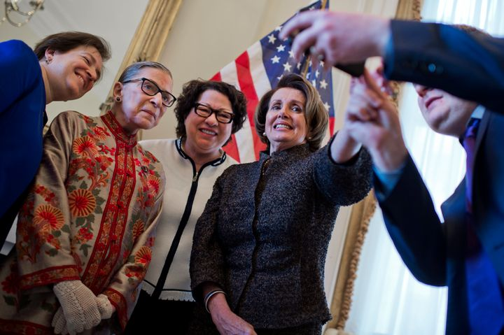From left: Supreme Court Justices Elena Kagan, Ruth Bader Ginsburg and Sonia Sotomayor take a photowith House Minority