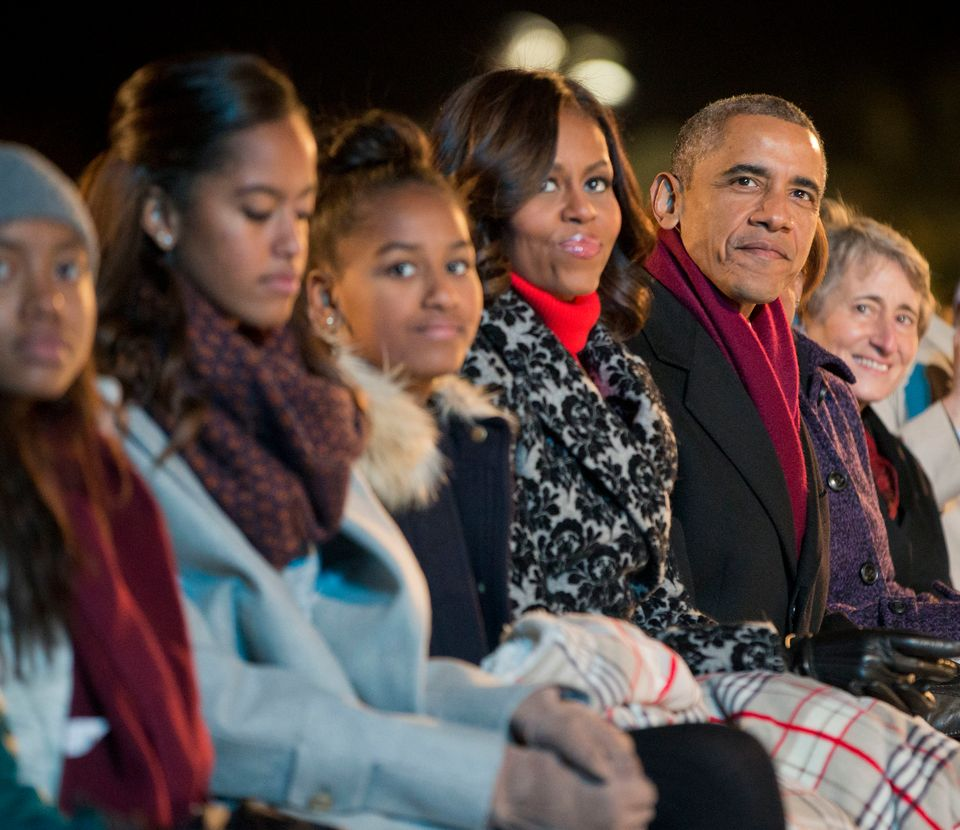 President Barack Obama, with daughters Malia and Sasha and first lady Michelle Obama, watch musical performances at the Natio