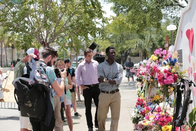 E:60 correspondent Bob Woodruff stands behind Chris Singleton at the memorial to the Charleston shooting victims.