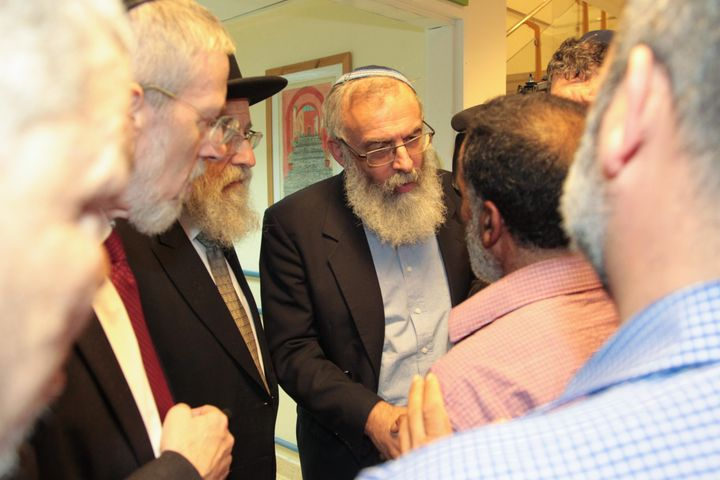 Rabbis meet with Ahmad's grandfather.