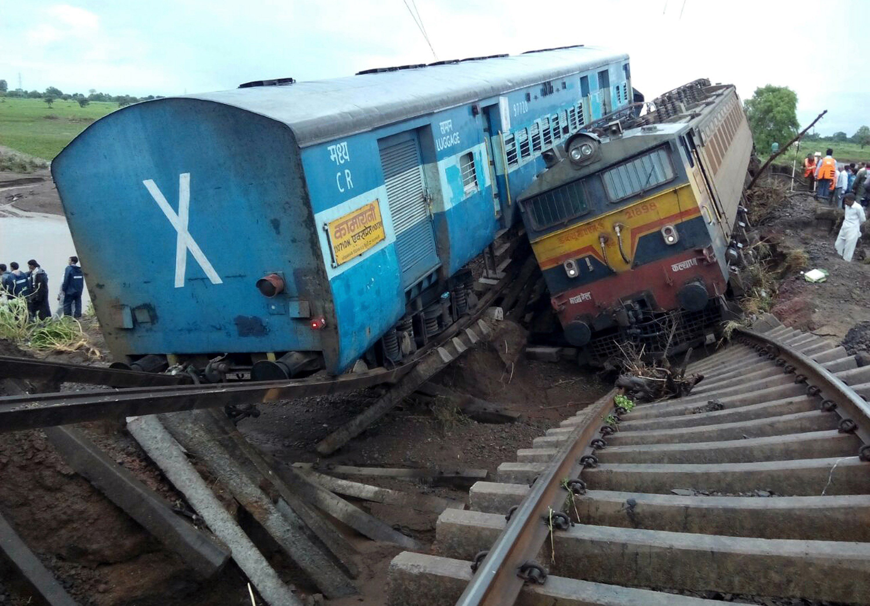 <p>Two Indian passenger trains lay next to each other following a derailment after they were hit by flash floods on a bridge outside Harda, India, on August 5, 2015. </p>