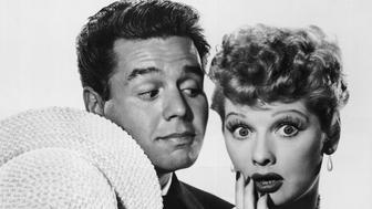 Cuban-born actor and musician Desi Arnaz (1917 - 1986) looks at his wife, the American actress Lucille Ball (1911 - 1989), as she expresses surprise in a publicity still for the television series 'I Love Lucy,' 1952. (Photo by CBS Photo Archive/Courtesy of Getty Images)
