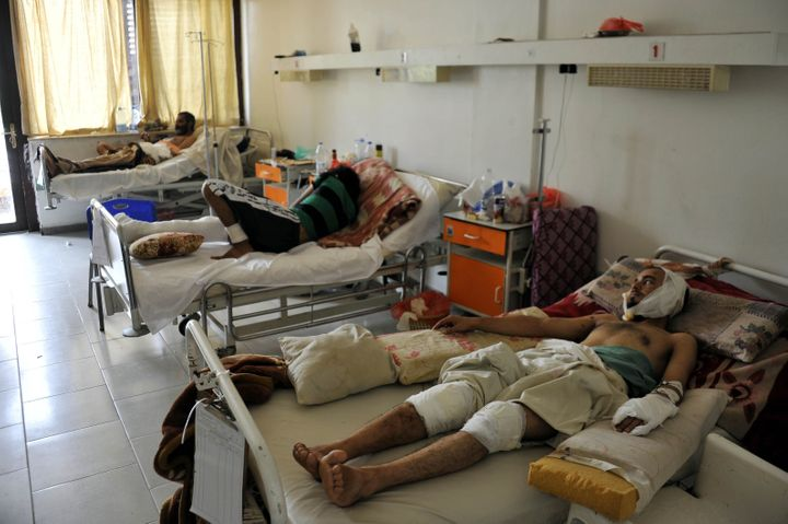 Yemeni men injured in Saudi-led coalition airstrikes at Al-Thawra Hospital in Sanaa, Yemen, on Aug. 1, 2015.