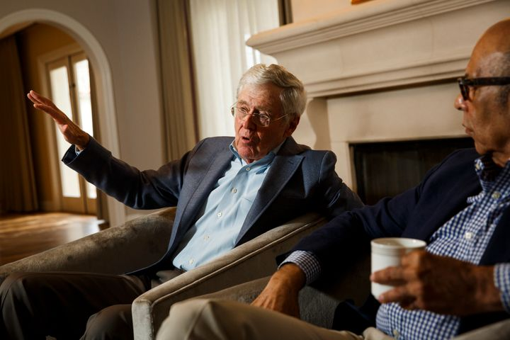 <span>Charles Koch and Dr. Michael Lomax, of the United Negro College Fund, speak during an interview with the Washington Pos
