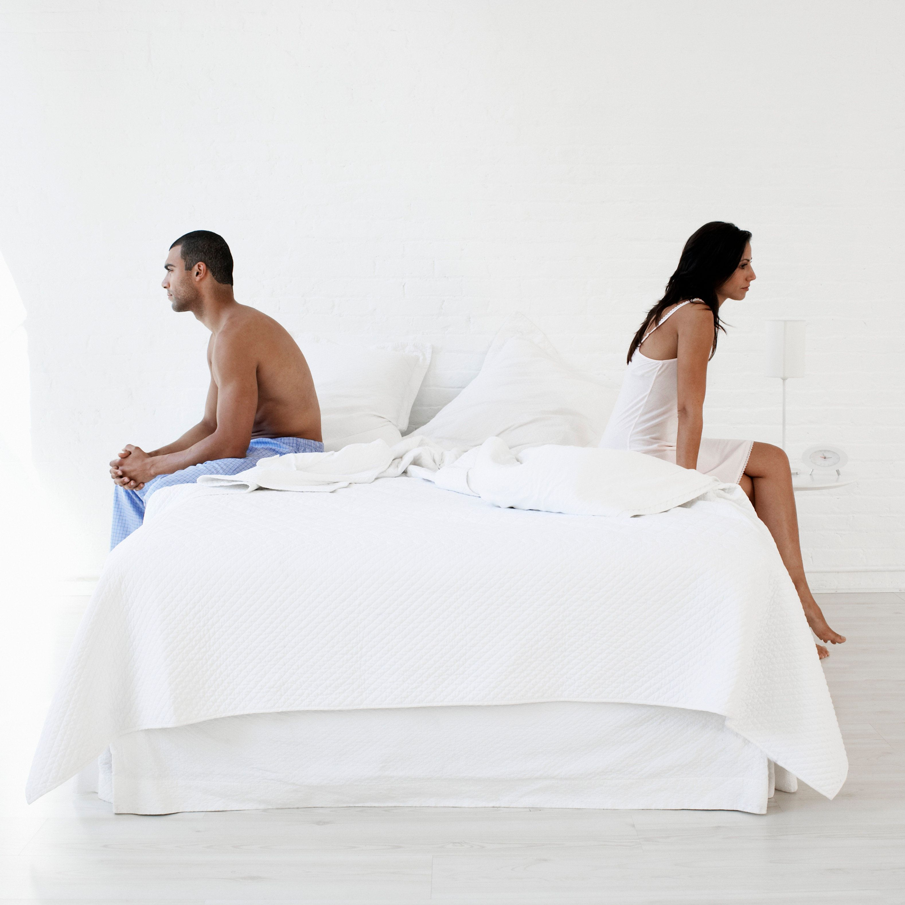 Couple Sitting on Bed