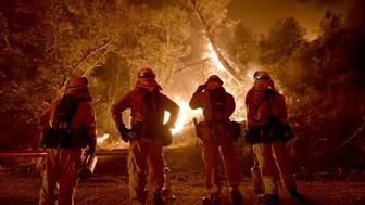 Cal Fire firefighters watch a back burn while fighting the Rocky fire off highway 20 near Clear Lake, California on August 2, 2015. The fire has charred more than 27,000 acres, and is currently only 5% contained. AFP PHOTO/JOSH EDELSON        (Photo credit should read Josh Edelson/AFP/Getty Images)