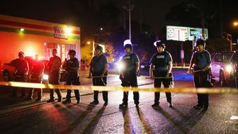 <p>Law enforcement block of a street in Ferguson during protests in the days after the death of Michael Brown.</p>