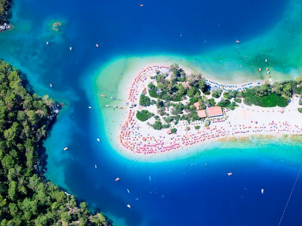 """<a href=""""http://www.lonelyplanet.com/turkey/mediterranean-coast/oludeniz"""">Paraglide over the water</a>, or simply soak in its"""