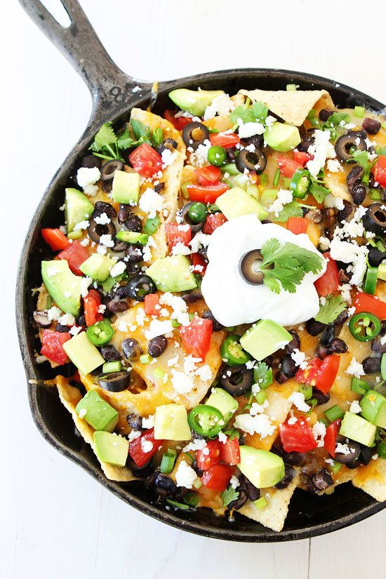 "<strong>Get the <a href=""http://www.twopeasandtheirpod.com/three-cheese-skillet-nachos/"" target=""_blank"">Three Cheese Skillet"