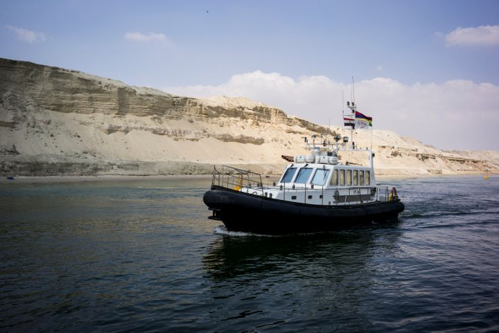 Boats pass through the New Suez Canal in Ismailia, Egypt, on June 13, 2015.
