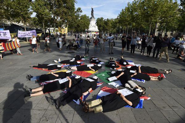 Anti-nuclear activists rally at the Place de la Republique in Paris, France, on Aug. 6, 2015.