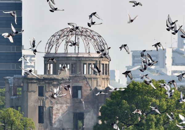Doves fly over the Hiroshima Peace Memorial Park in Japan on Aug. 6, 2015.