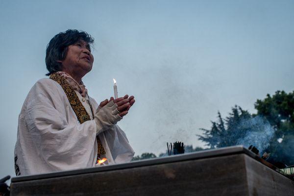 A woman offers prayers at the Hiroshima Peace Memorial Park in Hiroshima, Japan, on Aug. 6, 2015.