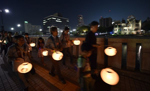 Peoplemarch with lanterns near the the Atomic Bomb Dome in Hiroshima, Japan, on Aug. 5, 2015.
