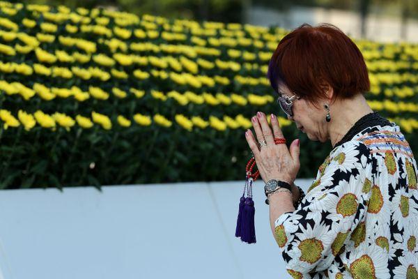 A woman offers prayersat the Hiroshima Peace Memorial Park in Hiroshima, Japan, on Aug. 5, 2015.