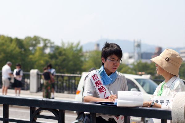 Students collect signatures for a nuclear abolition campaign in Hiroshima, Japan, on Aug. 4, 2015.