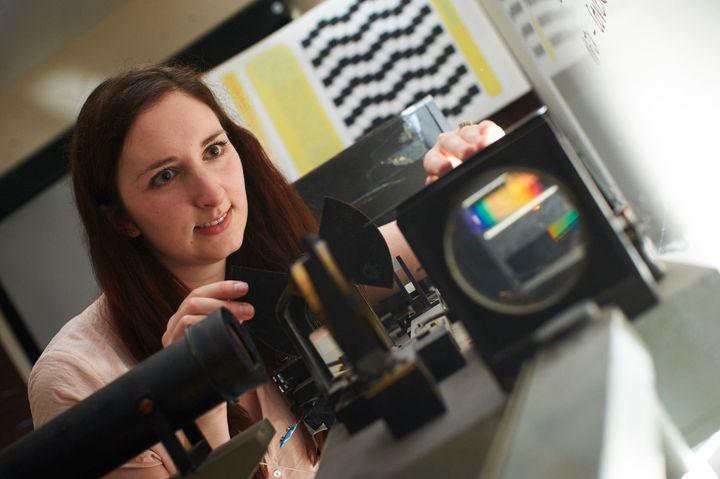 <span>Lauren Welbourne with a colorimeter machine.</span>