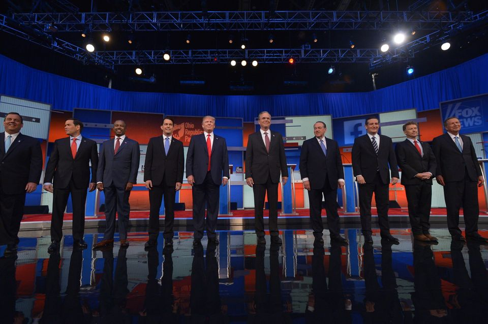 The top 10 Republican presidential hopefuls arrive on stage for the start of the prime time Republican presidential primary d