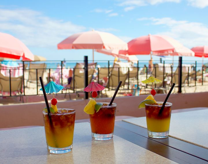<p>The Scratch Mai Tai, the Royal Mai Tai and the Mai Tai Degeneres at The Royal Hawaiian's Mai Tai Bar, looking over Waikiki Beach.</p>