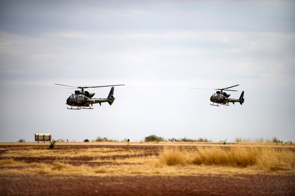 French Gazelle military helicopters, flying back from the city of Timbuktu, arrive at the French army base camp airport on Ja