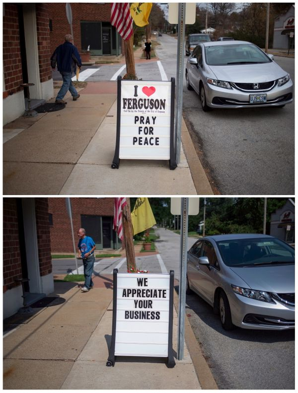 A combination picture shows a resident walking past a sign outside a business in Ferguson, Missouri on November 20, 2014 (top