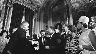 """<p><span style=""""font-family: Arial, Helvetica, sans-serif; font-size: 14px; line-height: 20px; background-color: #eeeeee;"""">President Lyndon B. Johnson and the Rev. Martin Luther King Jr. shake hands at the signing of the Voting Rights Act of 1965.</span></p>"""