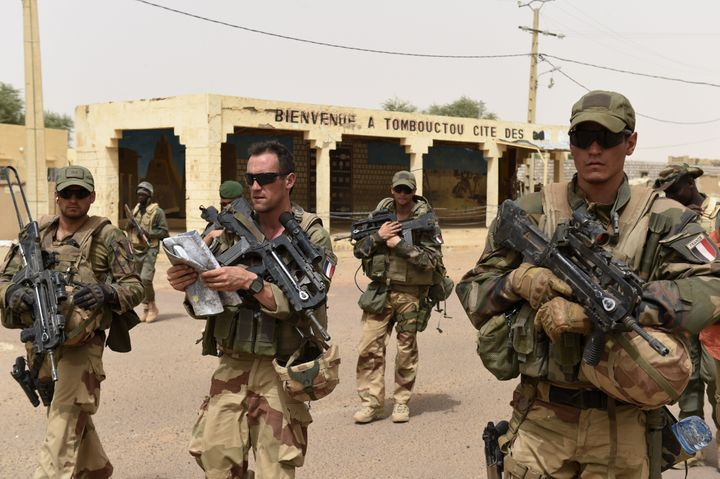 French and Malian soldiers patrol the streets in Timbuktu, Mali, on June 6, 2015.