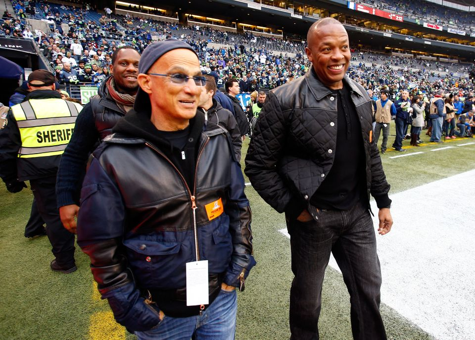 SEATTLE, WA - JANUARY 19:  Dr. Dre and music producer Jimmy Iovine on the field before the Seattle Seahawks take on the San F