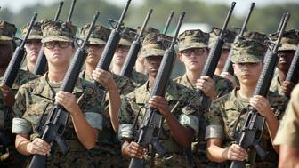 PARRIS ISLAND, SC - JUNE 22: Female Marine Corps recruits pratice drill at the United States Marine Corps recruit depot June 22, 2004 in Parris Island, South Carolina. Marine Corps boot camp, with its combination of strict discipline and exhaustive physical training, is considered the most rigorous of the armed forces recruit training. Congress is currently considering bills that could increase the size of the Marine Corps and the Army to help meet US military demands in Iraq and Afghanistan.