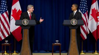 President Barack Obama and Canadian Prime Minister Stephen Harper speak in the South Court Auditorium on the White House complex in Washington, Wednesday, Dec. 7, 2011. (AP Photo/Carolyn Kaster)
