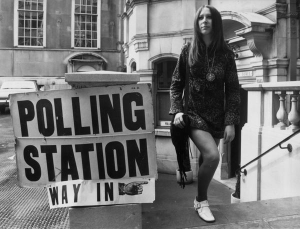 A woman votes in style in 1970.