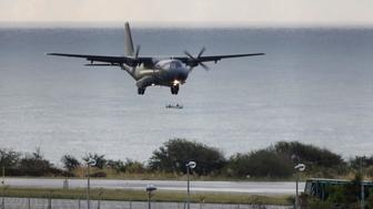 <p>A French Air Force plane taking part in the search for wreckage from the missing MH370 plane lands in Saint-Marie on the island of La Reunion on Aug. 7, 2015.</p>