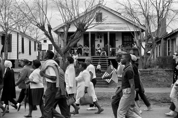 Marchers on the way to Montgomery as families watch from their porches, 1965.