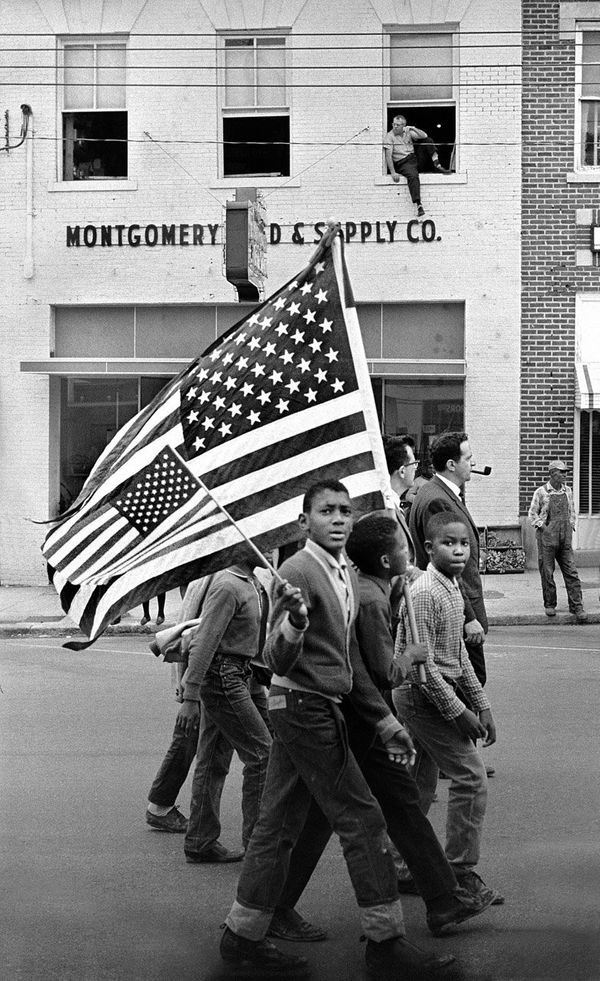 Young civil rights marchers with American flags march in Montgomery, 1965.