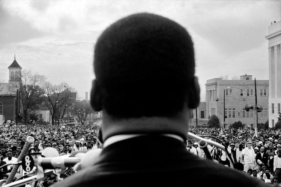 Dr. Martin Luther King Jr. Looks out at crowd in Montgomery, 1965.