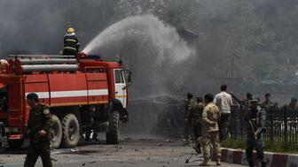 Afghan firefighters spray water at the site of a bomb attack near the entrance to Kabul's international airport in Kabul on August 10, 2015. A huge blast struck near the entrance of Kabul's international airport on August 10 during the peak lunchtime period, officials said, warning that heavy casualties were expected. 'The explosion occurred at the first check point of Kabul airport,' said deputy Kabul police chief Sayed Gul Agha Rouhani. AFP PHOTO / Wakil Kohsar        (Photo credit should read WAKIL KOHSAR/AFP/Getty Images)