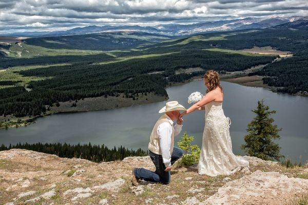 """""""This photowas taken high above Meadowlark Lake, located in the Bighorn Mountains of Wyoming. The groom proposed to the"""