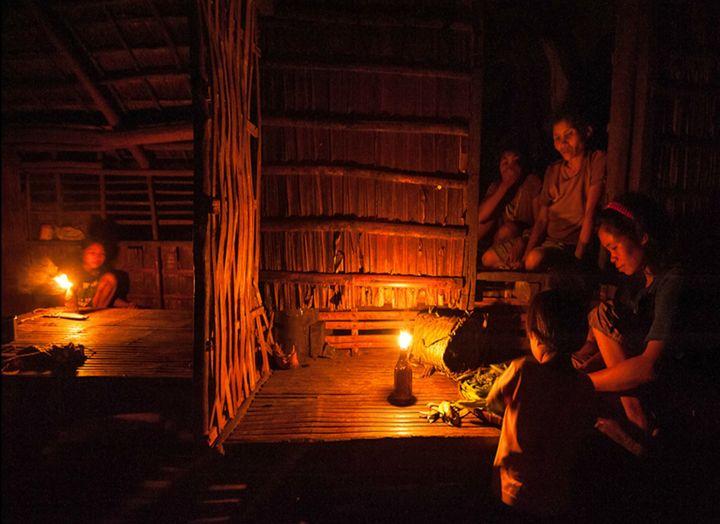 <span>A family using a kerosene lamp</span>