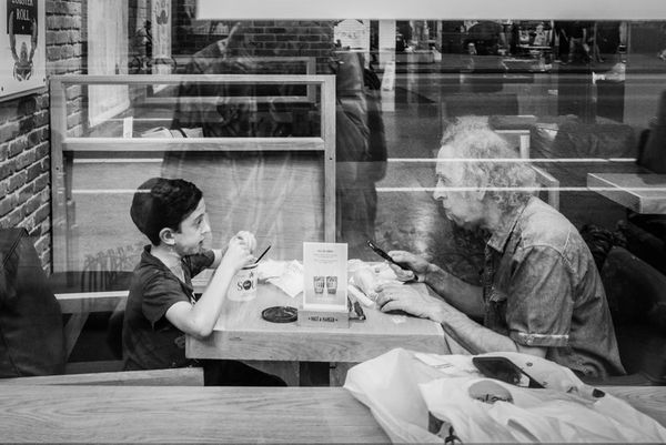 "<span style=""color: #000000;"">I was passing by this restaurant and looked inside and saw this boy with his grandfather sharin"