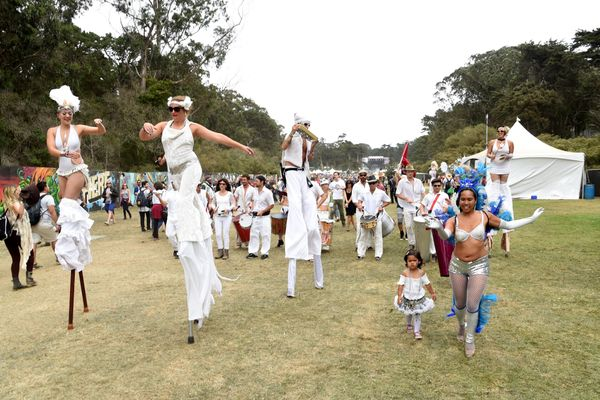 The Whiteout Parade traipsed across the festival grounds.
