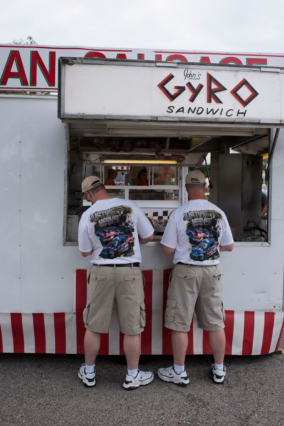 Twins wait for food at a concession stand at the 40th annual Twins Days Festival.