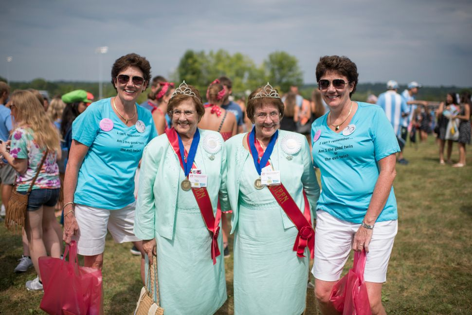From left, Dorris Fejka, Charlotte and Rose Italiano and Donna Saxman pose for a portrait at the Twins Days Festival.