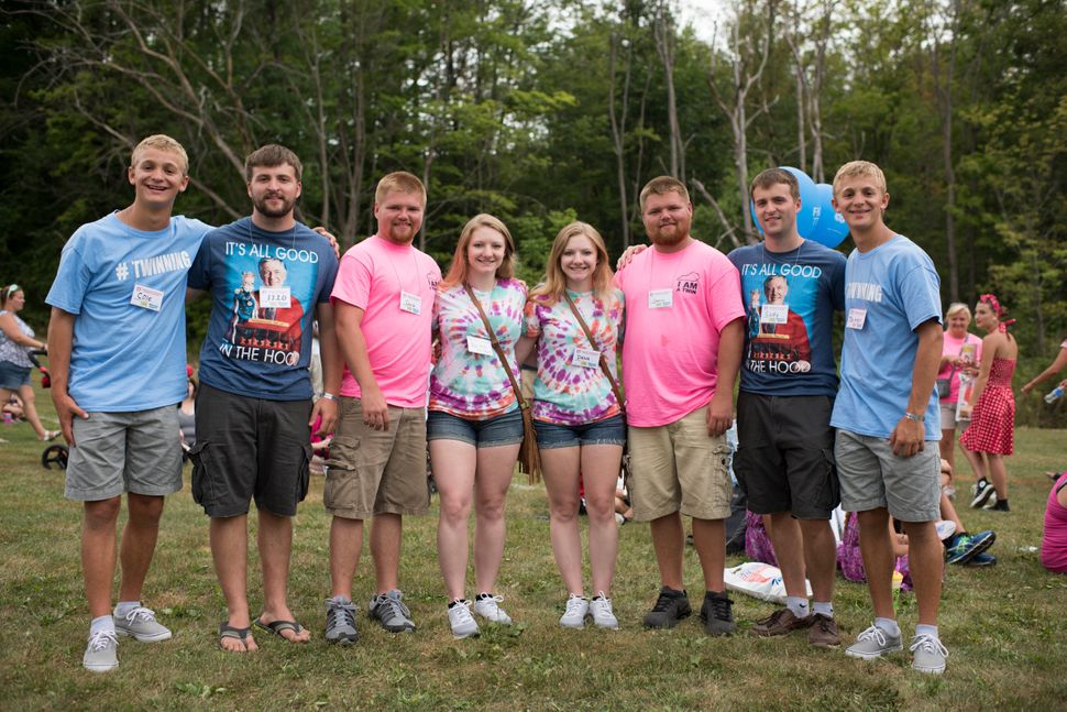 Groups of identical twins pose for a portrait at the 40th annual Twins Days Festival.