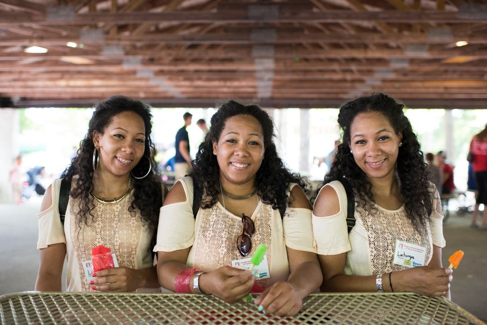 Identical triplets Latrina, Latasha and Latoya Thompson, 25, from Detroit, attend the Twins Days Festival for the first time.