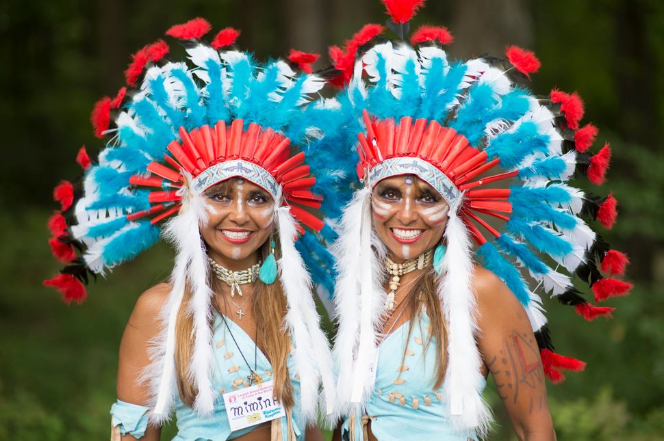 Mimina and Marita Meza Vergara, 35, from Venezuela, pose for a portrait at the 40th annual Twins Days Festival. Twins seem to